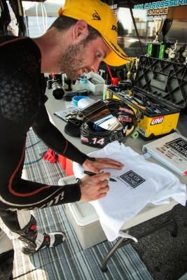 Samuel Trepanier signing some t-shirt for fans